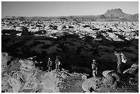 Hikers on Petes Mesa ridge above the Maze. Canyonlands National Park, Utah, USA. (black and white)