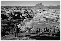 Group hiking down into the Maze. Canyonlands National Park, Utah, USA. (black and white)