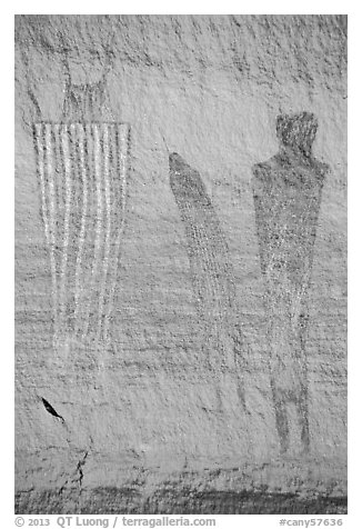 Bowing to large anthropomorphic figure with white stripes, Harvest Scene. Canyonlands National Park (black and white)