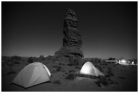 Camp at the base of Standing Rock at night. Canyonlands National Park, Utah, USA. (black and white)