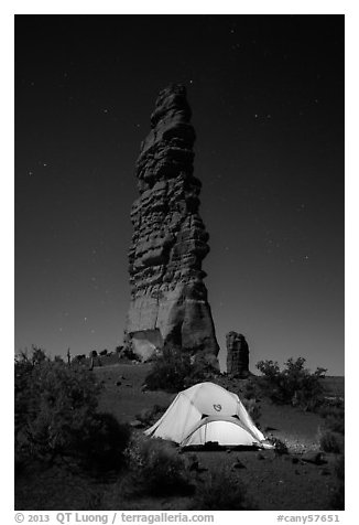 Tent at the base of Standing Rock at night. Canyonlands National Park (black and white)