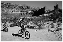 Mountain bikers in Teapot Canyon, Maze District. Canyonlands National Park, Utah, USA. (black and white)