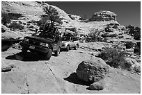 Vehicles on ledge in Teapot Canyon. Canyonlands National Park, Utah, USA. (black and white)