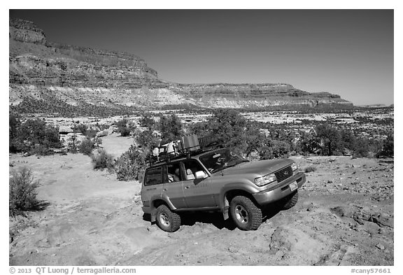 4WD vehicle driving over rocks in Teapot Canyon. Canyonlands National Park (black and white)