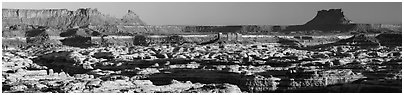 Maze canyons and Chocolate Drops from Standing Rock, early morning. Canyonlands National Park (Panoramic black and white)