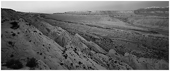 Earth crust wrinkle of  Waterpocket Fold at dusk. Capitol Reef National Park (Panoramic black and white)