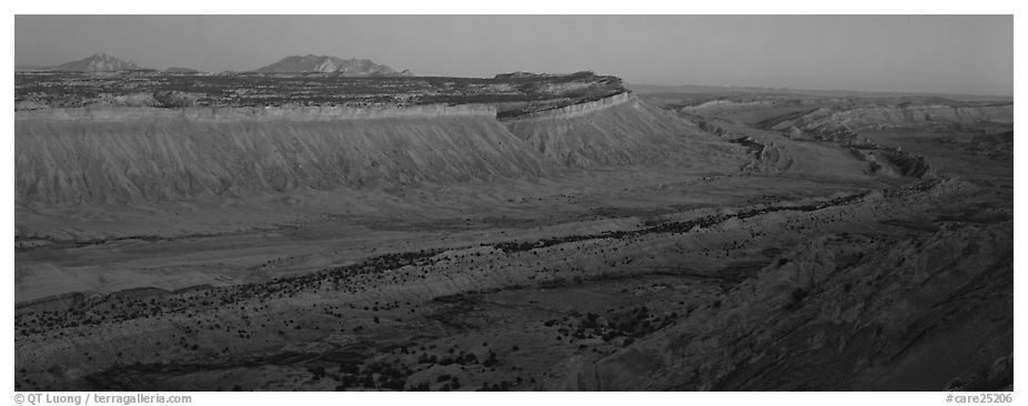 Long chain of cliffs of the Waterpocket Fold at dusk. Capitol Reef National Park (black and white)