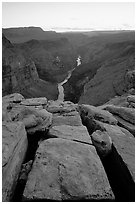 Cracks and Colorado River at Toroweap, dusk. Grand Canyon National Park, Arizona, USA. (black and white)