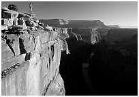 Hiker looking down into  Grand Canyon at Toroweap, early morning. Grand Canyon National Park ( black and white)