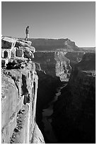 Man standing at  edge of  Grand Canyon at Toroweap, early morning. Grand Canyon National Park ( black and white)