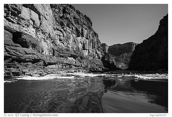 River-level view of glassy waters before rapids, Marble Canyon. Grand Canyon National Park (black and white)