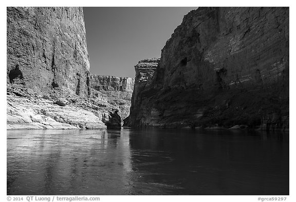 River-level view of redwall limestone canyon walls dropping straight into Colorado River. Grand Canyon National Park (black and white)