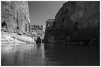 River-level view of redwall limestone canyon walls dropping straight into Colorado River. Grand Canyon National Park ( black and white)