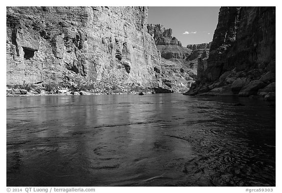 Colorado River flowing between steep cliffs in Marble Canyon. Grand Canyon National Park (black and white)