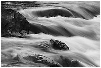 Boulders and rapids with color from canyon walls reflected. Grand Canyon National Park ( black and white)