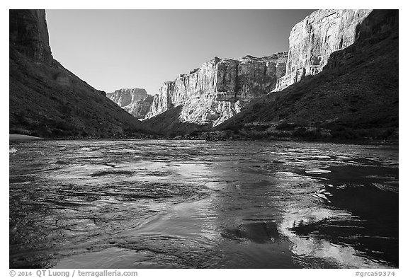 Cliffs reflected in Colorado River rapids, morning. Grand Canyon National Park (black and white)
