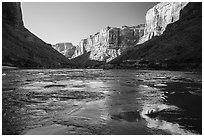 Cliffs reflected in Colorado River rapids, morning. Grand Canyon National Park ( black and white)