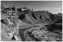 Photographer on steep cliff above Unkar rapids. Grand Canyon National Park ( black and white)