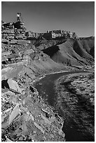 Photographer on sheer cliff above Unkar rapids. Grand Canyon National Park ( black and white)