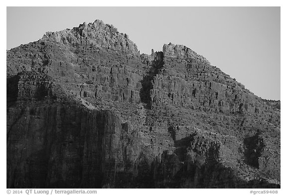 Last light illuminates distant cliffs. Grand Canyon National Park (black and white)