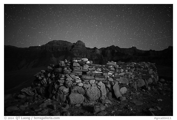Ancient ruin and South Rim at night. Grand Canyon National Park (black and white)