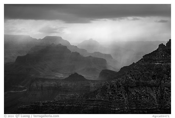 Canyon ridges with dramatic clouds and sunrays. Grand Canyon National Park (black and white)
