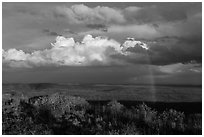 Rainbow and thunderstorm clouds over mesa. Mesa Verde National Park, Colorado, USA. (black and white)