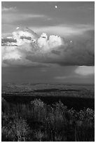 Moon, thunderstorm cloud over mesas at sunset. Mesa Verde National Park, Colorado, USA. (black and white)