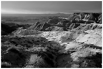 Badlands of  Chinle Formation seen from Whipple Point, stormy sunset. Petrified Forest National Park, Arizona, USA. (black and white)