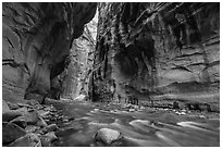 Virgin River flowing beneath tall walls, the Narrows. Zion National Park ( black and white)