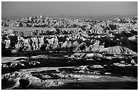 View over eroded ridges from Pinacles overlook, sunrise. Badlands National Park, South Dakota, USA. (black and white)