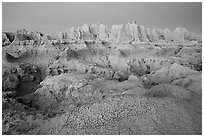 Cracked mud and erosion formations, Cedar Pass, dawn. Badlands National Park, South Dakota, USA. (black and white)