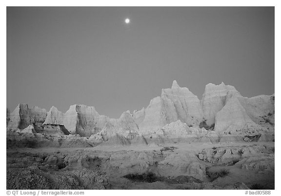Moon and eroded badlands, Cedar Pass, dawn. Badlands National Park (black and white)