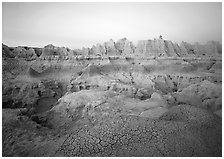 Cracked mudstone and eroded towers near Cedar Pass, dawn. Badlands National Park, South Dakota, USA. (black and white)
