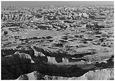 Prairie and eroded ridges stretching to horizon, early morning. Badlands National Park ( black and white)