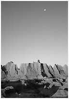 Moon and erosion formations, Cedar Pass, dawn. Badlands National Park, South Dakota, USA. (black and white)
