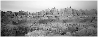 Badlands formations with pastel hues at dawn. Badlands National Park (Panoramic black and white)