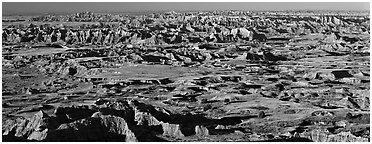 Scenic view of prairie and badlands extending to horizon, Pinnacle Overlook. Badlands National Park (Panoramic black and white)