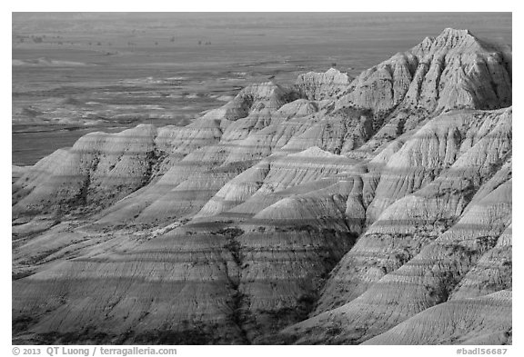 Eroded sedimentary rock layers at sunrise. Badlands National Park (black and white)