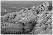 Eroded sedimentary rock layers at sunrise. Badlands National Park ( black and white)