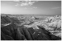 Park visitor looking, Panorama Point. Badlands National Park, South Dakota, USA. (black and white)