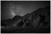 Starry sky and Milky Way above buttes. Badlands National Park, South Dakota, USA. (black and white)