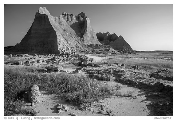 Brule formation butte raising from prairie. Badlands National Park (black and white)