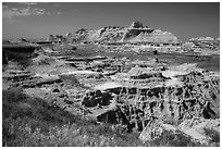 Badlands below and above prairie. Badlands National Park, South Dakota, USA. (black and white)