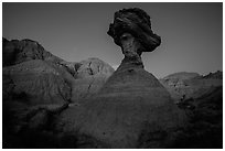 Pedestal rock at badlands at dusk. Badlands National Park, South Dakota, USA. (black and white)