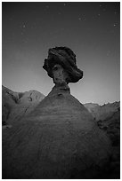 Pedestal rock at badlands at night. Badlands National Park, South Dakota, USA. (black and white)