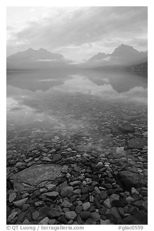 Peebles in lake McDonald and mountains. Glacier National Park (black and white)