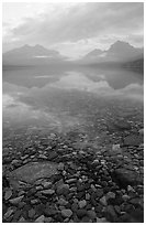 Peebles in lake McDonald and mountains. Glacier National Park, Montana, USA. (black and white)