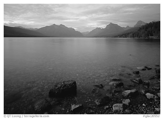 Rocks, Lake Mc Donald, and mountains at sunset. Glacier National Park (black and white)