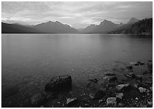 Rocks, Lake Mc Donald, and mountains at sunset. Glacier National Park ( black and white)